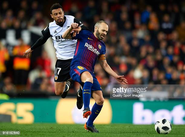 Francis Coquelin of Valencia competes for the ball with Andres Iniesta of Barcelona during the Copa del Rey semifinal second leg match between...