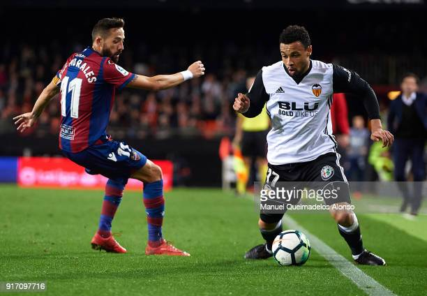 Francis Coquelin of Valencia competes for the ball with Jose luis Morales of Levante during the La Liga match between Valencia and Levante at...