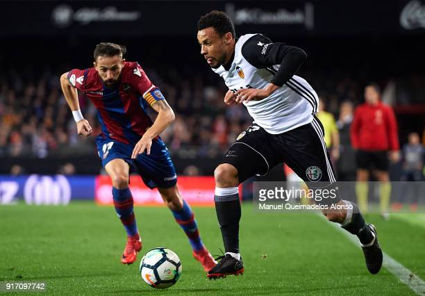 Francis Coquelin of Valencia runs with the ball during the La Liga match between Valencia and Levante at Mestalla Stadium on February 11 2018 in...