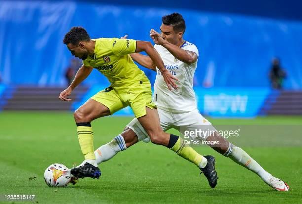 Francis Coquelin of Villarreal CF and Carlos H. Casemiro of Real Madrid CF battle for the ball during the LaLiga Santander match between Real Madrid...