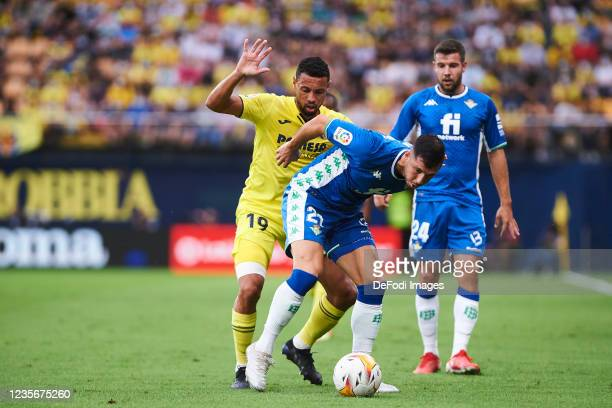 Francis Coquelin of Villarreal CF and Guido Rodriguez of Real Betis battle for the ball during the LaLiga Santander match between Villarreal CF and...