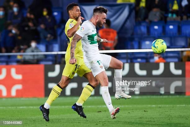 Francis Coquelin of Villarreal CF and Jose Antonio Ferrandez, Josan of Elche CF battle for the ball during the LaLiga Santander match between...