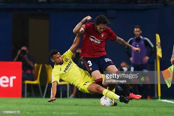 Francis Coquelin of Villarreal CF and Juan Cruz of CA Osasuna battle for the ball during the La Liga Santander match between Villarreal CF and CA...
