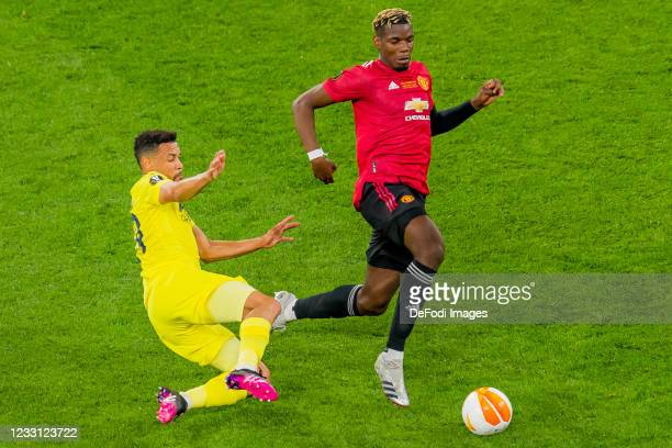 Francis Coquelin of Villarreal CF and Paul Pogba of Manchester United battle for the ball during the UEFA Europa League Final between Villarreal CF...