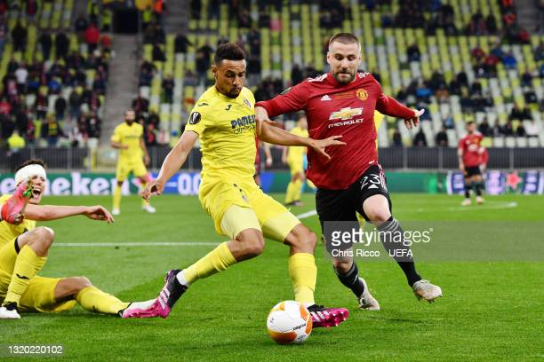 Francis Coquelin of Villarreal CF battles for possession with Luke Shaw of Manchester United during the UEFA Europa League Final between Villarreal...