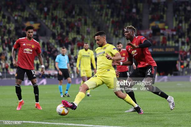 Francis Coquelin of Villarreal CF battles for possession with Paul Pogba of Manchester United during the UEFA Europa League Final between Villarreal...