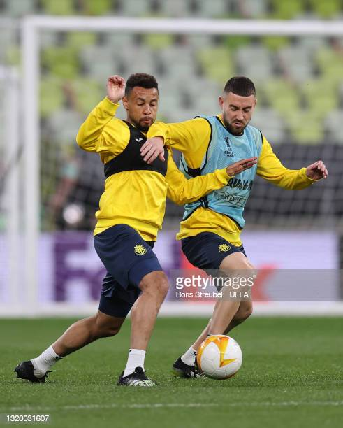 Francis Coquelin of Villarreal CF battles for possession with team mate Moi Gomez during the Villarreal CF Training Session ahead of the UEFA Europa...