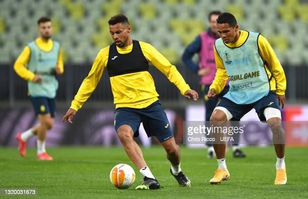 Francis Coquelin of Villarreal CF battles for possession with team mate Carlos Bacca during the Villarreal CF Training Session ahead of the UEFA...