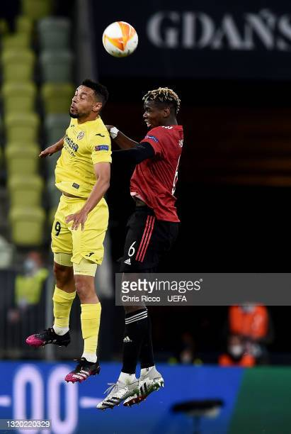 Francis Coquelin of Villarreal CF competes for a header with Paul Pogba of Manchester United during the UEFA Europa League Final between Villarreal...