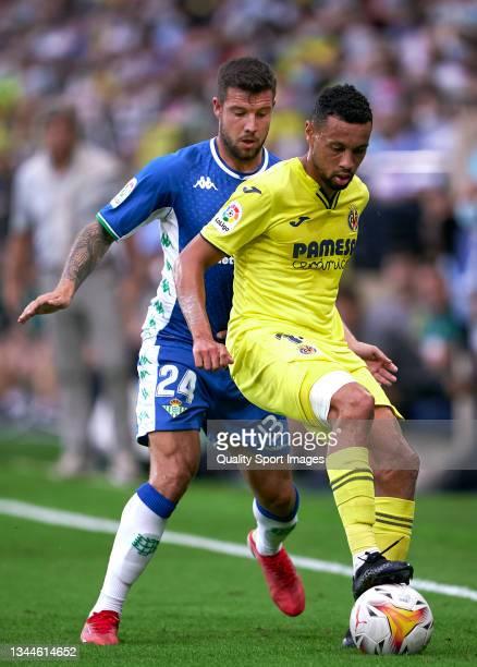 Francis Coquelin of Villarreal CF competes for the ball with Aitor Ruibal of Real Betis during the La Liga Santander match between Villarreal CF and...