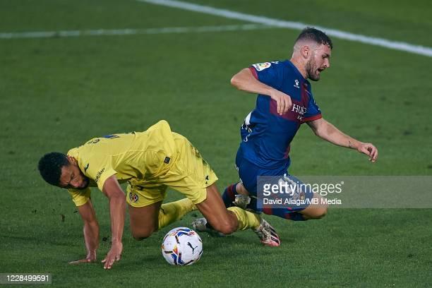 Francis Coquelin of Villarreal CF competes for the ball with Galan of SD Huesca during the La Liga Santander match between Villarreal CF and SD...