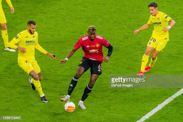 Francis Coquelin of Villarreal CF, Paul Pogba of Manchester United and Yeremy of Villarreal CF battle for the ball during the UEFA Europa League...