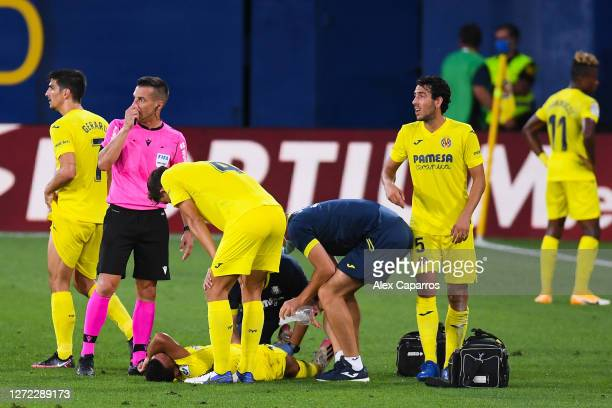 Francis Coquelin of Villarreal CF reacts injured on pitch during the La Liga match between Villarreal CF and SD Huesca at Estadio de la Ceramica on...