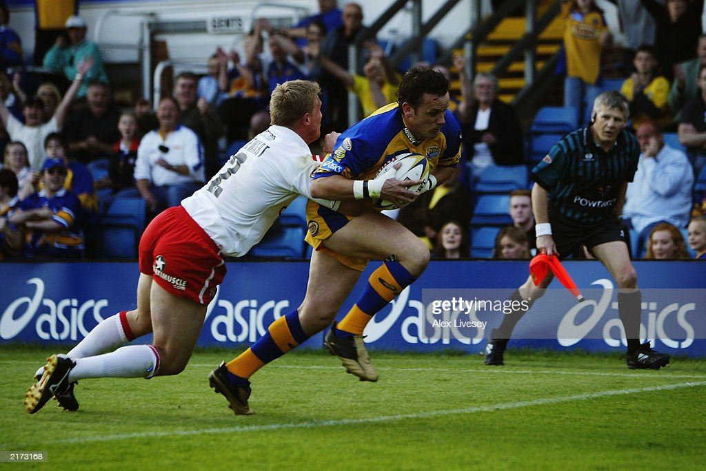 Francis Cummins of Leeds Rhinos evades the tackle of Anthony Stewart of St Helens to score a try during the Tetley's Super League match between Leeds Rhinos and St Helens held on June 13, 2003 at the Headingley Stadium in Leeds, England. Leeds Rhinos won the match 20-14.