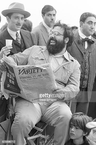 Francis Ford Coppola laughs over an item in Variety magazine with Robert De Niro during the shooting of 'The Godfather Part II', Sicily, 1973.