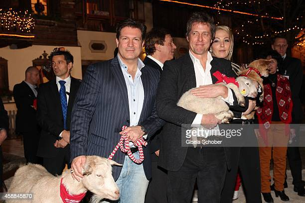 Francis Fulton Smith and Hugh Grant with lamb during the Opening of the Gut Aiderbichl Christmas Market on November 11 2014 in Henndorf am Wallersee...