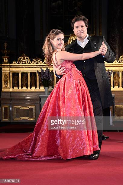 Francis Fulton Smith and Jeanette Biedermann pose on stage after the 'Everyman' Photo Rehearsal at Berliner Dom on October 15 2013 in Berlin Germany