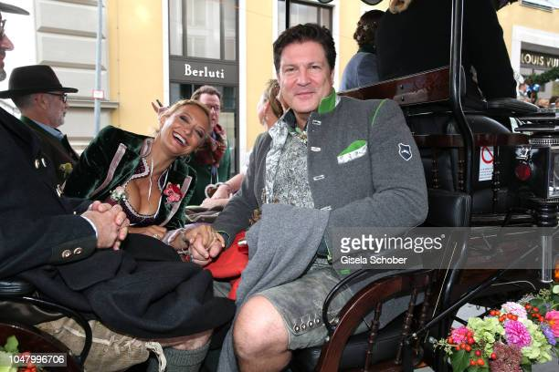 Francis FultonSmith and his girlfriend Claudia Maria Hillmeier during the 'Fruehstueck bei Tiffany' at Tiffany Store ahead of the Oktoberfes on...
