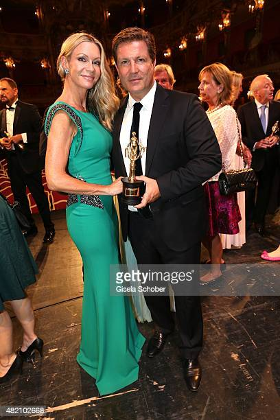 Francis FultonSmith and his wife Verena Klein with award during the 'Die Goldene Deutschland' Gala on July 26 2015 at Cuvillies Theater in Munich...