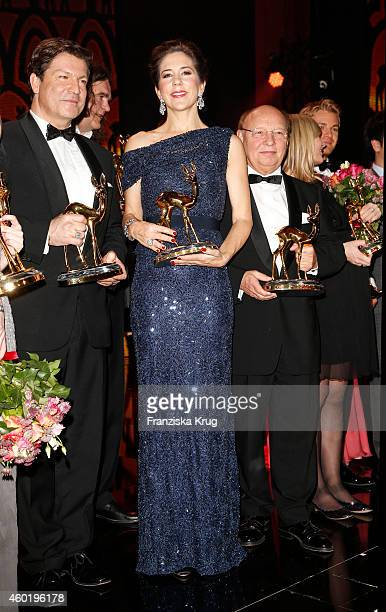 Francis FultonSmith and Princess Mary of Denmark pose with their awards after the Bambi Awards 2014 show on November 14 2014 in Berlin Germany