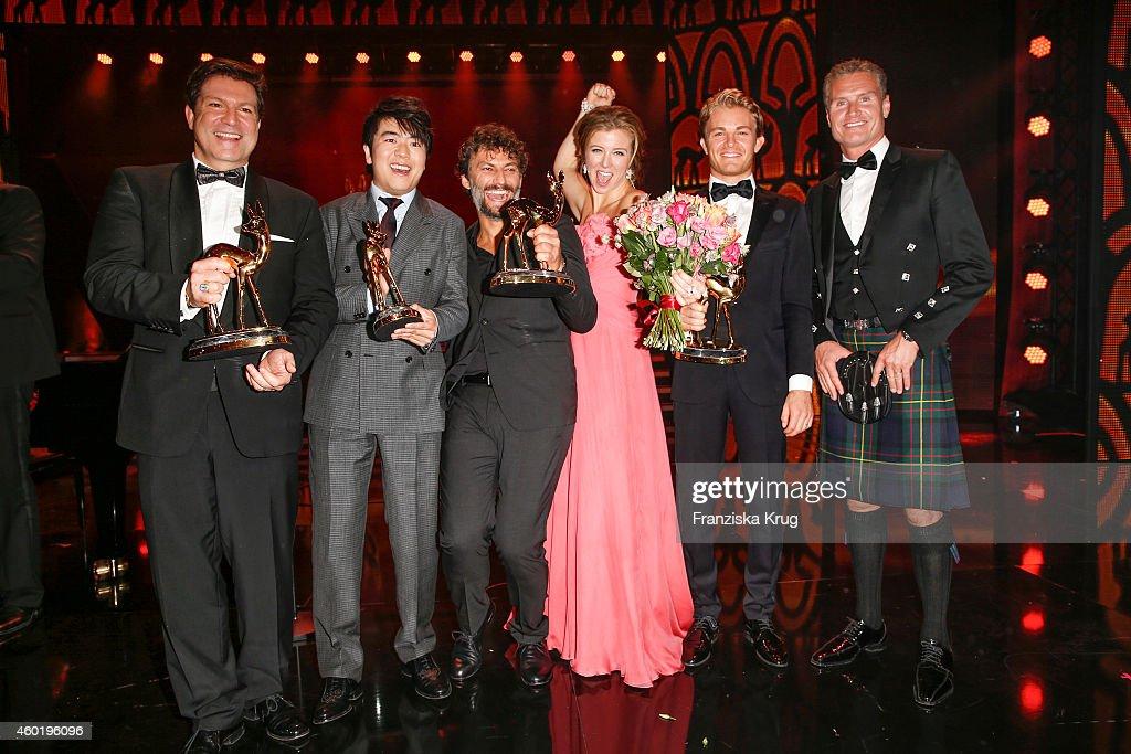 Francis Fulton-Smith, Lang Lang, Jonas Kaufmann, Nina Eichinger, Nico Rosberg and David Coulthard pose after the Bambi Awards 2014 show on November 14, 2014 in Berlin, Germany.
