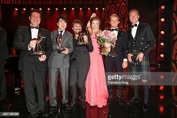 Francis FultonSmith Lang Lang Jonas Kaufmann Nina Eichinger Nico Rosberg and David Coulthard pose after the Bambi Awards 2014 show on November 14...