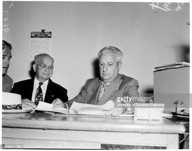 Francis H. Van Wie, 4 May 1953. Francis H. Van Wie ;Officer John Heitman;Attorney Bernard J Cohen.;Caption slip reads: 'Photographer: Hecht. Date:...