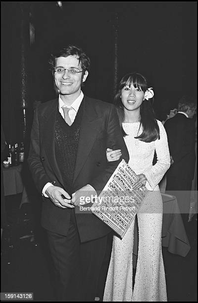 Francis Huster and Mei Chen Chalais attend a party at Paradis Latin cabaret in Paris in 1977