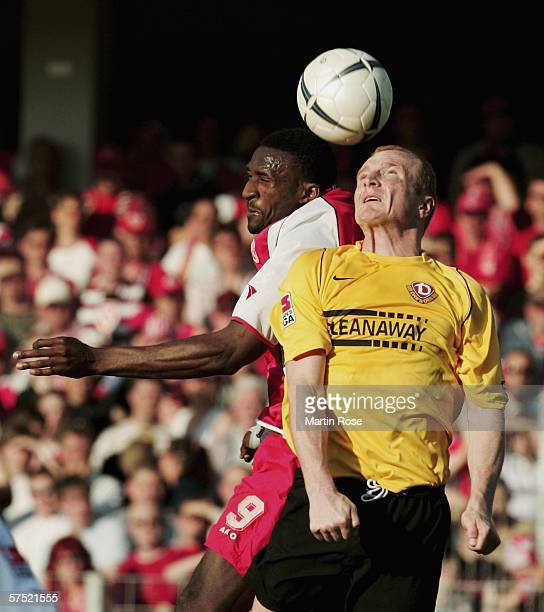 Francis Kioyo of Cottbus and Mariusz Kukielka of Dresden go up for a header during the Second Bundesliga match between Energie Cottbus and Dynamo...