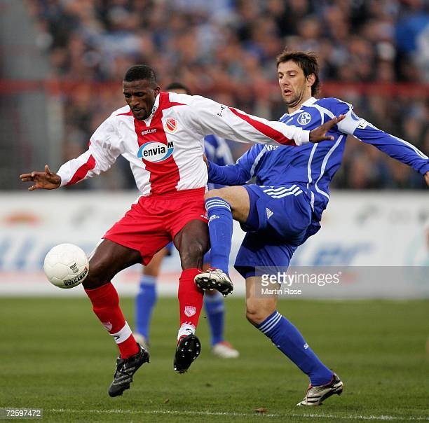 Francis Kioyo of Cottbus and Mladen Krstajic of Schalke compete for the ball during the Bundesliga match between Energie Cottbus and Schalke 04 at...