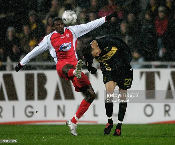 Francis Kioyo of Cottbus tackles Cristzian Fiel of Aachen during the Second Bundesliga match between Alemannia Aachen and Energie Cottbus, at the...