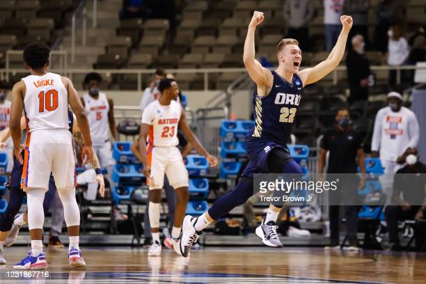 Francis Lacis of the Oral Roberts Golden Eagles celebrates the Eagles victory over the Florida Gators in the second round of the 2021 NCAA Division I...