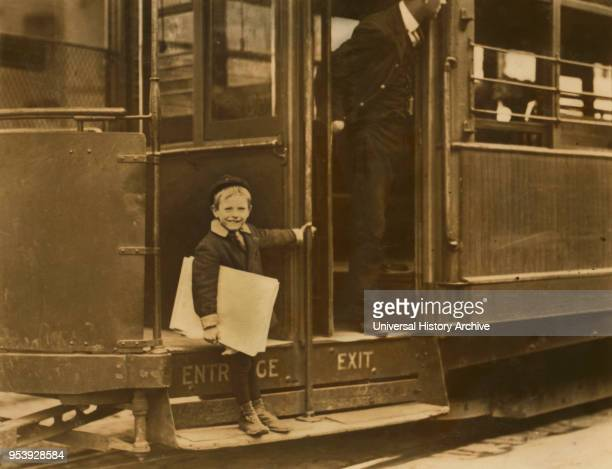 Francis Lane 5yearold Newsboy Portrait Riding on Street Car Grand Avenue St Louis Missouri USA Lewis Hine for National Child Labor Committee May 1910