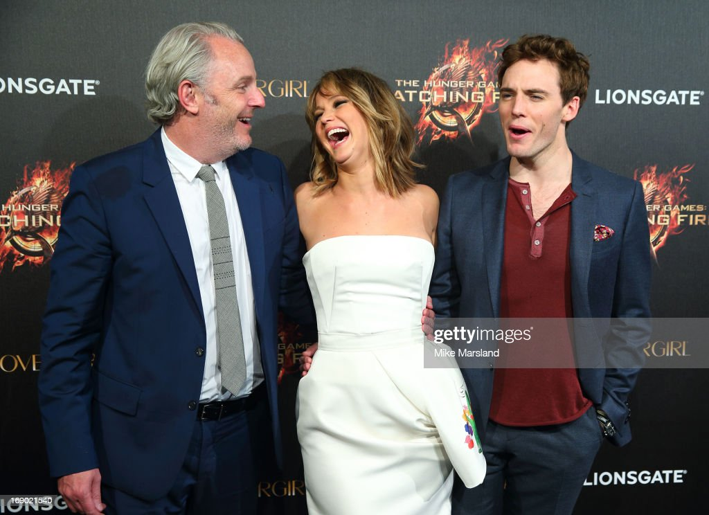 Francis Lawrence, Jennifer Lawrence and Sam Claflin attend a party for 'The Hunger Games: Catching Fire' at The 66th Annual Cannes Film Festival at Baoli Beach on May 18, 2013 in Cannes, France.