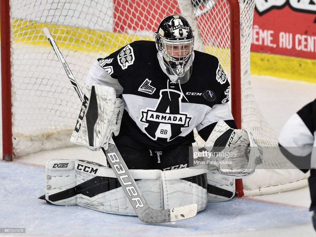 Francis Leclerc #34 of the Blainville-Boisbriand Armada makes a save in the second period against the Drummondville Voltigeurs during the QMJHL game at Centre d'Excellence Sports Rousseau on October 27, 2017 in Boisbriand, Quebec, Canada. The Blainville-Boisbriand Armada defeated the Drummondville Voltigeurs 2-0.