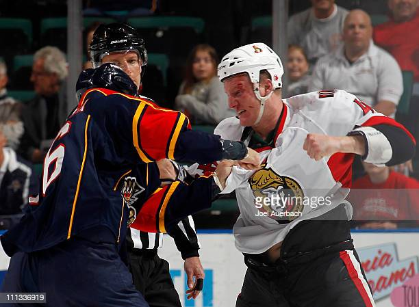 Francis Lessard of the Ottawa Senators and Darcy Hordichuk of the Florida Panthers fight during the first period on March 31 2011 at the BankAtlantic...