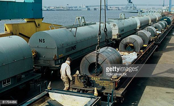 Francis McFalls an employee of the South Jersey Port Corporation in Camden NJ watches 07 March 2002 as a 60000 pound coil of steel imported from...