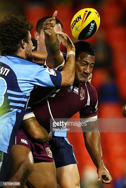 Francis Molo of Queensland offloads during the U20s State of Origin match between New South Wales and Queensland at Centrebet Stadium on April 20,...