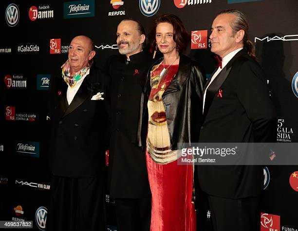 Francis Montesinos, Miguel Bose and Paola Dominguin pose during a photocall for 'Fifth Gala Against HIV 2014' at the Museu Nacional d'Art de...