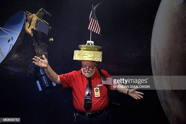 Francis Murphy poses with a New Horizons probe hat at the Johns Hopkins University Applied Physics Laboratory July 14 2015 in Laurel Maryland The...