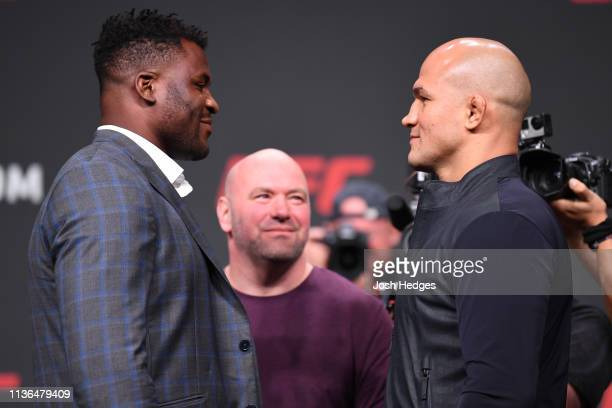 Francis Ngannou of Cameroon and Junior Dos Santos of Brazil Dos Santos face off during the UFC Seasonal Press Conference inside State Farm Arena on...