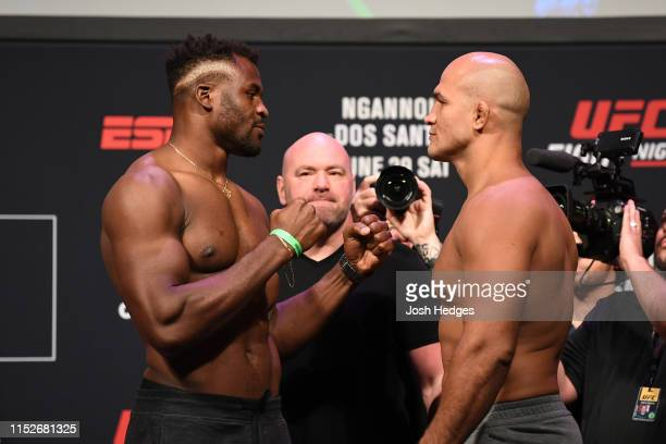 Francis Ngannou of Cameroon and Junior Dos Santos of Brazil face off during the UFC Fight Night weighin at the Target Center on June 28 2019 in...