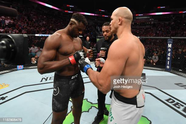 Francis Ngannou of Cameroon and Junior Dos Santos of Brazil face off prior to their heavyweight bout during the UFC Fight Night event at the Target...