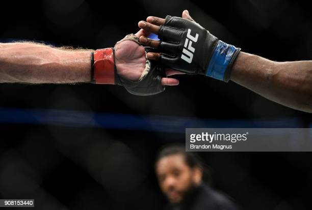 Francis Ngannou of Cameroon and Stipe Miocic touch gloves in their heavyweight championship bout during the UFC 220 event at TD Garden on January 20...