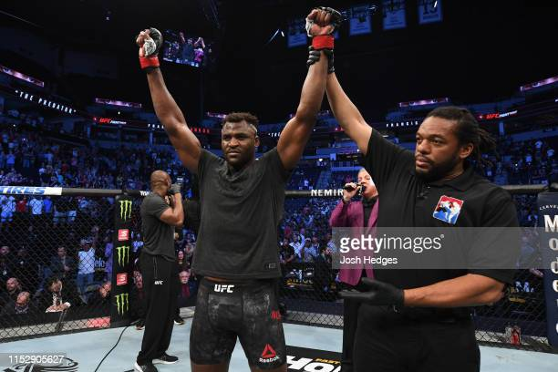 Francis Ngannou of Cameroon celebrates after defeating Junior Dos Santos of Brazil by TKO in their heavyweight bout during the UFC Fight Night event...