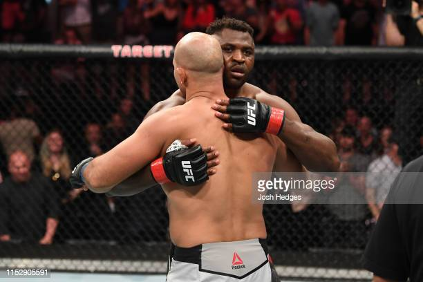Francis Ngannou of Cameroon embraces Junior Dos Santos of Brazil after defeating Dos Santos by TKO in their heavyweight bout during the UFC Fight...