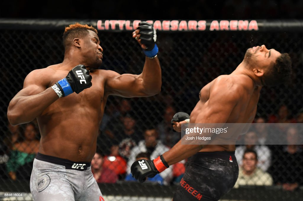 Francis Ngannou of Cameroon punches Alistair Overeem of The Netherlands in their heavyweight bout during the UFC 218 event inside Little Caesars Arena on December 02, 2017 in Detroit, Michigan.