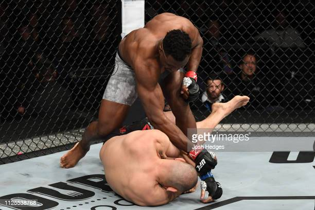 Francis Ngannou of Cameroon punches Cain Velasquez in their heavyweight bout during the UFC Fight Night event at Talking Stick Resort Arena on...