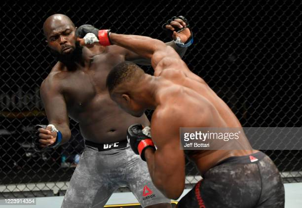 Francis Ngannou of Cameroon punches Jairzinho Rozenstruik of Suriname in their heavyweight fight during the UFC 249 event at VyStar Veterans Memorial...