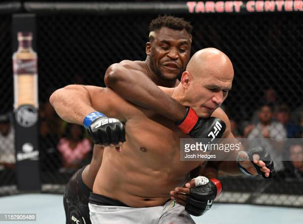 Francis Ngannou of Cameroon punches Junior Dos Santos of Brazil in their heavyweight bout during the UFC Fight Night event at the Target Center on...